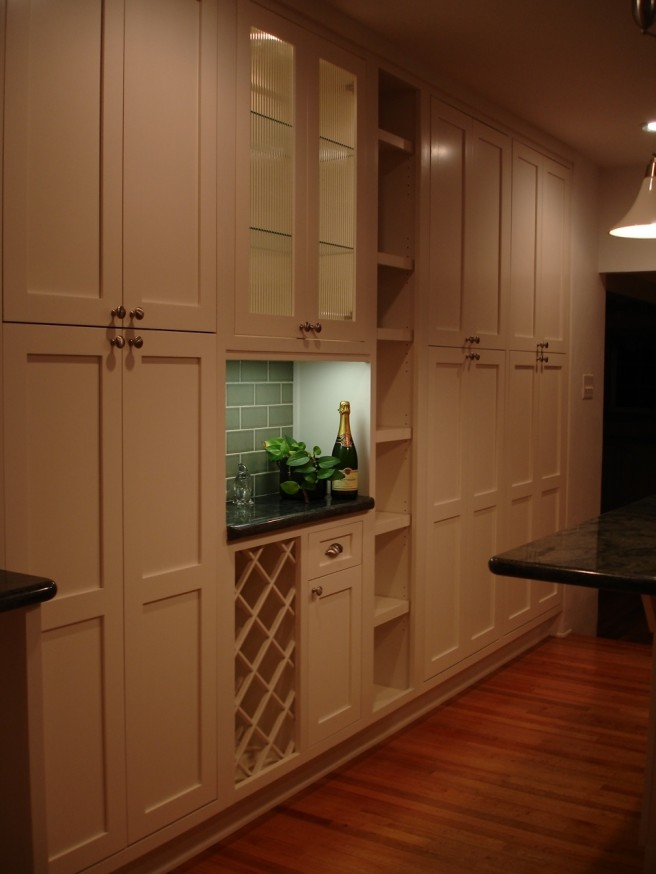 Kitchen cabinets and open shelving, wine storage